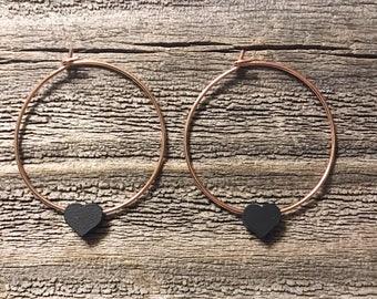 Rose gold hoop earrings with matte black heart
