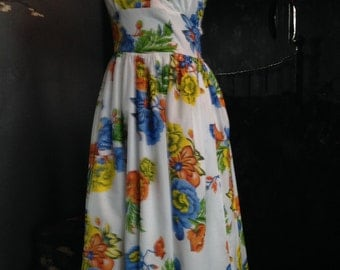 A 1950's inspired .tie back halter dress in a wonderful vibrant flower print