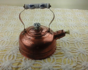 Vintage, copper tea kettle with porcelain handles.