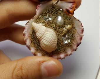 Handmade shell pendant with sand, glitter, gems, shells, resin and a pearl