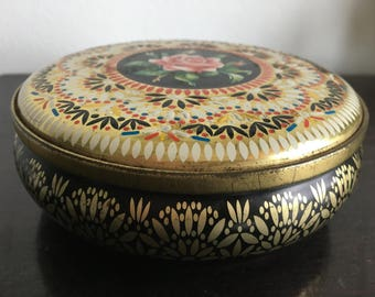 round floral tin