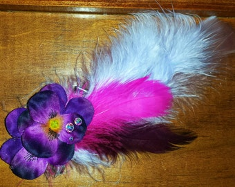Purple and pink feathered hair clip with purple flowers and Swarovski crystal accents.