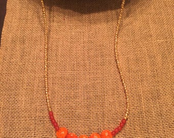 Red and orange long beaded necklace