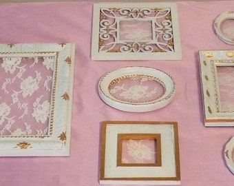 Frame collection of 7 white w/gold leaf detail, lace inset  shabby chic