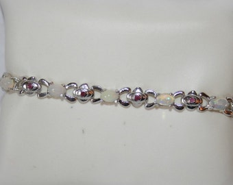 Bracelet in Silver 925 set with real opals + Ruby