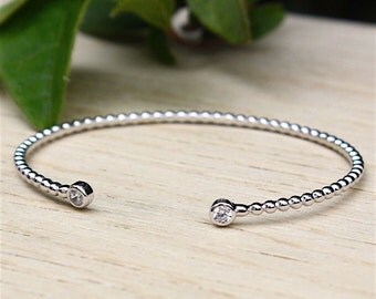 Bracelet ring twisted silver massif and zircon