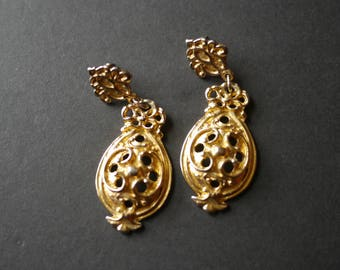 Large ornate statement gold tone vintage earrings for pierced ears
