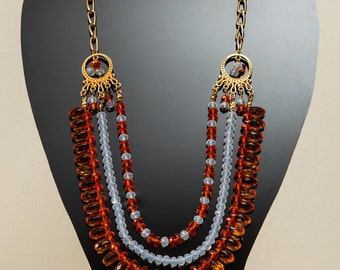 Beautiful orange, white and gold necklace with earrings.