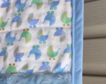 Baby boy blue stroller quilt