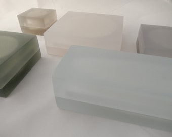 NICE-CUBE jewelry box with magical transparency. An elegant frosted polyester container.