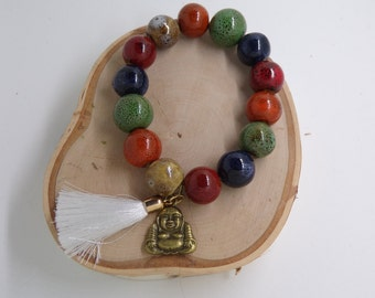 B1237 Multi Colored Ceramic Stone Bracelet with Buddha Charm and Tassel.