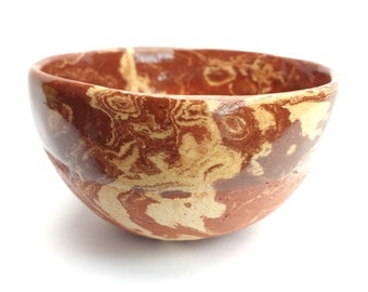 A Ceramic /  Pottery marbled terracotta and cream clay pinch pot bowl. Perfect for home decor, prep bowl, trinkets .