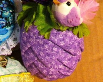 Lilac floral fabric pinecone ornament.