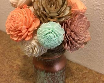 Floral arrangment design in a copper vase