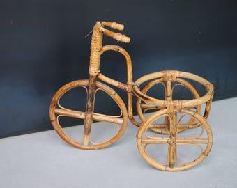Door tricycle plant antique vintage rattan