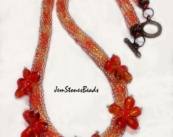 Free shipping. Orange rope necklace with flowers