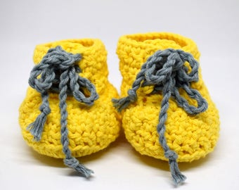 """Shoes """"sneakers"""" crochet yellow with blue laces all gentle on baby birth gift. Hand made in Switzerland & unique."""
