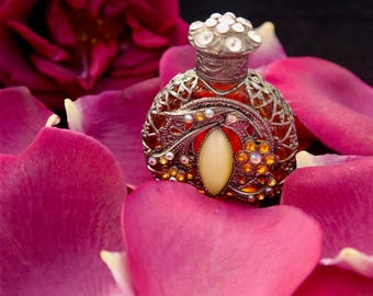Bottle of ancient Czech perfume, amber bottle rhinestone and stone, bottle essential oil, gothic