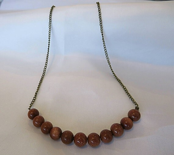 The sun tan and Brown stones and metal necklace
