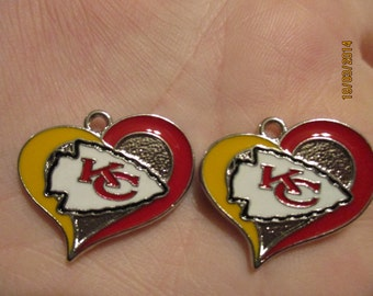Set of 2 Kansas City Chiefs heart charms.