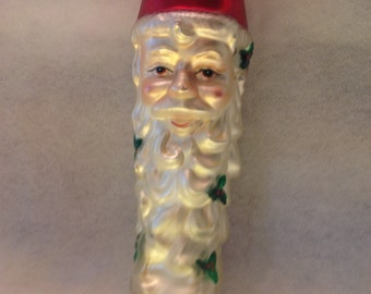 Over 10 inches A Magnificant crescent ahapped Santa smiling made of heavy glass
