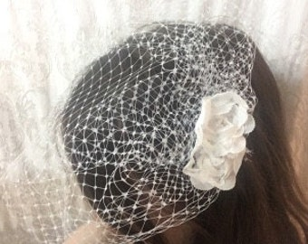 white birdcage bridal netting headpiece with flowers