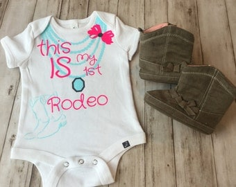 Rodeo Onesie This is my first rodeo Baby cowgirl onesie Baby girl rodeo shirt Clothes for rodeo kid's Cowgirl shirt Stock show shirt girl's