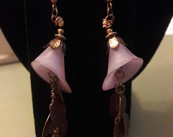 Purple floral dangle earrings with leaves and crystals