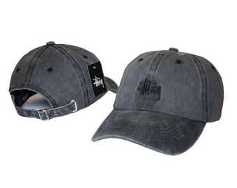 Distressed grey Stussy baseball cap