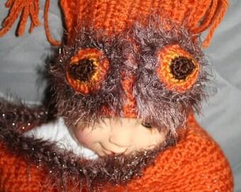Baby cocoons. Orange owl.