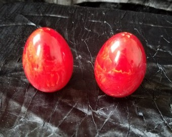 Vintage red marbled egg shaped salt and pepper shakers