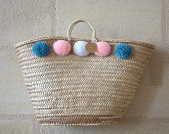 Great Bohemian basket with braided tassels also called wicker basket
