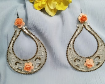 Pearl acetate earrings adorned with coral color flowers and old gold metal balls. Party earrings. Valentine's Day gift.
