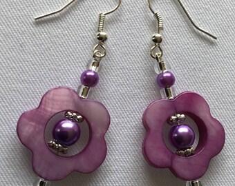 A pair of purple dangly earrings