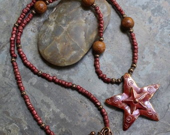 "Necklace 23"", with Patricia Healey copper double star, red and natural wood beads, copper twist hook and ring, N014"