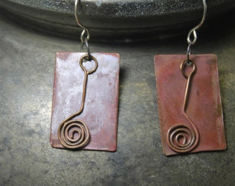 Hand forged copper with spiral overlay