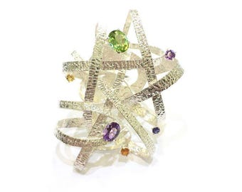 Ring in 925 silver with amethysts, peridot, citrine quartz and iolite