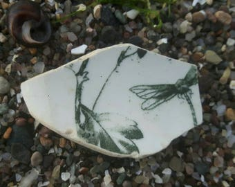 Double sided sea worn pottery piece dragon fly