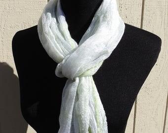 Pale apple green merino nuno felted onto Margilan silk - scarf