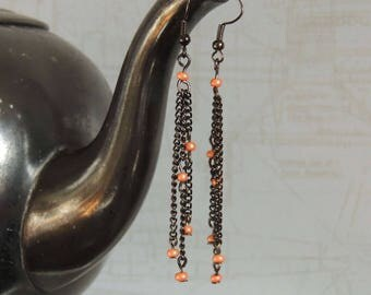 Long earrings with orangefabenen seed