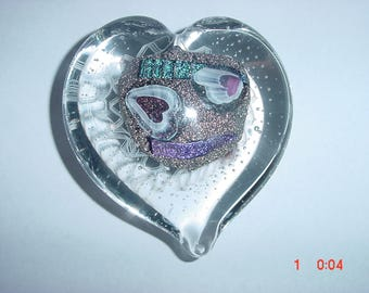 Beautiful glass heart paperweight.