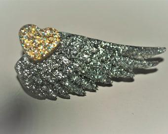 Heart winged brooch