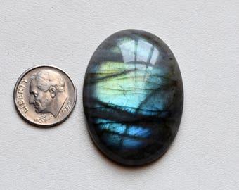 Natural Blue Flashy oval shape Labradorite , Hand Polished , 38 x 28 - Code 16