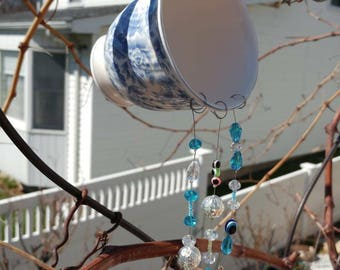 Blue cup suncatcher.