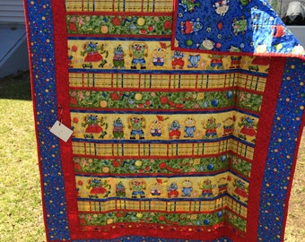 Cutest baby monsters baby quilt, bright colors, handmade. Measures 39 x 52 in.