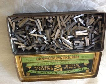 Printers dotted line 10 points in a collectors cigarettes metal box