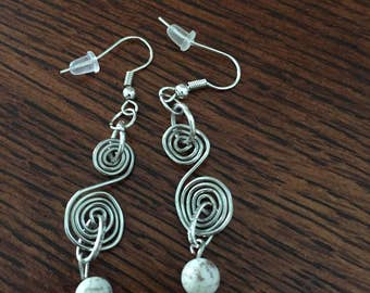 Hand wrapped silver swirl earrings accented with white beads