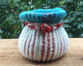 Hand knitted and felted around glass vase