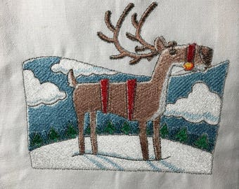 Reindeer snow and trees Tea Towel