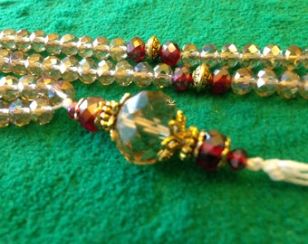 Smokey Crystal and Deep Red Accent Prayer Beads with a Crystal Tear-Drop Tassel